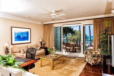 """Living room with ocean view in Main Villa! - with pull-out gel memory foam sofa bed and 55"""" SMART TV, DVD player and ceiling fan."""