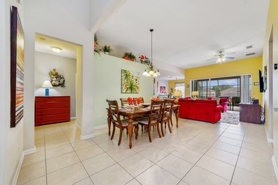 Open floor plan  features dining area, living room and kitchen.