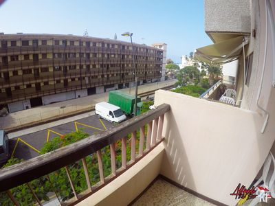 Photo for Apartment with sunny balcony + WIFI next to the beach