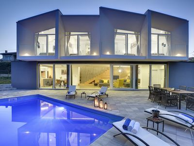 Photo for Modern villa with private pool, air conditioning, WiFi, 4 bedrooms with sea views, BBQ and only 1.3 km to the pebble beach