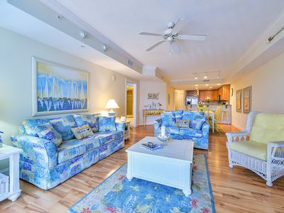 Photo for Upscale, adorable 3-bedroom luxury condo with precious coastal decor, free WiFi, and an outdoor pool located uptown and just a block from the beach!