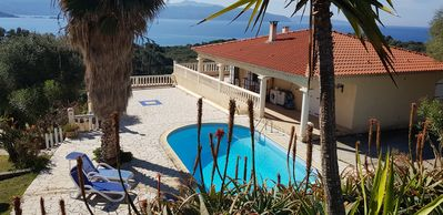 Photo for Villa Liamone - Apartment with pool and sea view, 400 meters from the beach