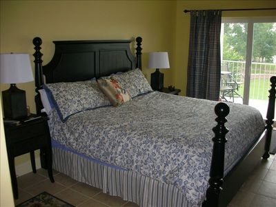 Master Suite with King Bed and balcony view of the lake