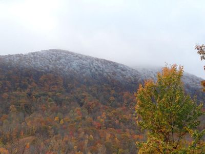 Fall view with the snow covering the peaks of the mountains