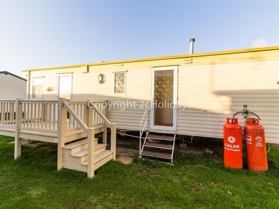 Photo for 6 berth caravan for hire by the beach in Heacham in Norfolk. ref 21014