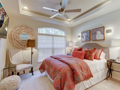 I'd say..this is a very pretty guest room!