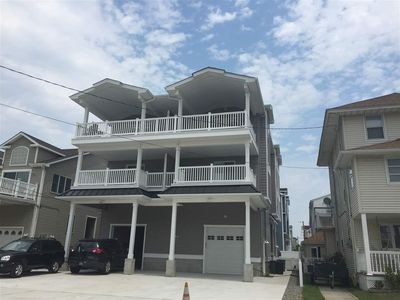 Photo for CLOSE to town and a short walk to the beach. Elevator. LARGE COVERED DECK.  PARKING