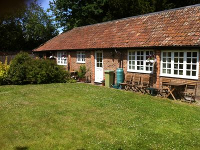 Photo for 2 Single storey cottages near village amenities ideal for couples and families