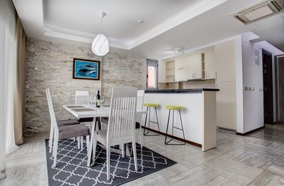 Modern dining room area & kitchen with all the amenities