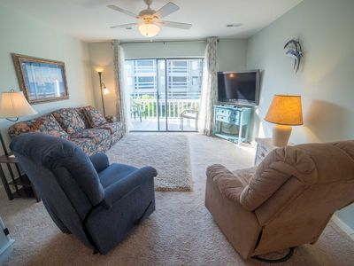Photo for Central Villa - Short Walk to the Beach and 3 Pools!