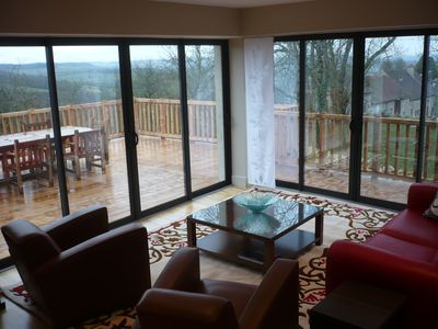 living room and the deck with stunning views of the village and  the valley
