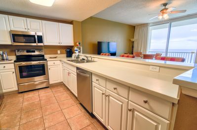 Spacious kitchen with stainless steel appliances for all of those family meals!