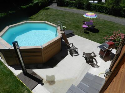 Photo for Modern wooden chalet with heated pool jacuzzi spa and sauna