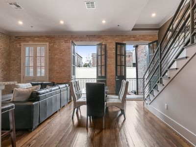 Modern,large condo in historical building with balcony over courtyard