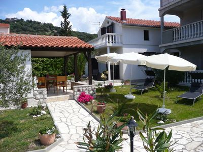 Photo for Holiday apartment beautiful terrace and garden, air conditioning