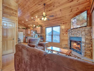 At ease - Stretch out on the plush sofa and watch TV, curl up in the armchair with a good book, enjoy après-ski drinks by the stacked-stone fireplace: You're going to love it here at Magic Moments II.
