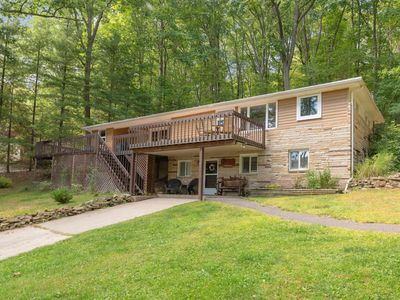 Dog friendly lake access home with dock slip, foosball table, fireplace, and a fire pit!