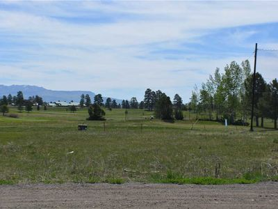 Photo for Walking distance to Pagosa Springs Golf Course, 3 bedrooms, 2 bath, 2 car garage log cabin.