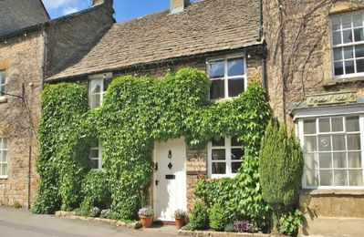 Photo for Whitsun Cottage is a beautiful, double fronted Cotswold stone cottage, clad in Virginia creeper