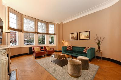The large, elegant lounge with ample seating, Smart TV, Free WiFi and Fireplace