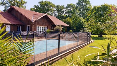 Photo for ARCACHON BASIN HOUSE 200m2 / 13 / 14PERS / 6CH / 4SDE / 2WC SECURE SWIMMING POOL / 2000M2