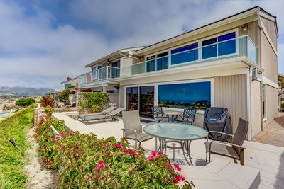Deck has ocean view, tables, loungers, gas grill, perfect for entertaining.