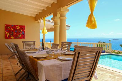 """After a long day at the beach, enjoy a gorgeous dinner on our colorful terrace"""