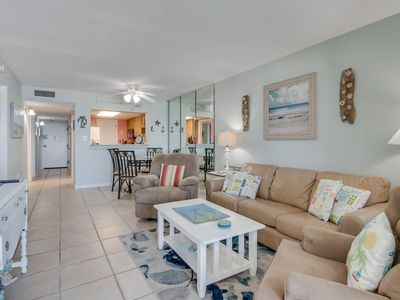 Photo for Beachfront condo with stunning gulf views, shared pool, bbq & fitness room