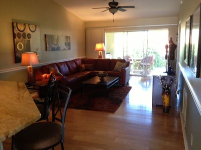 Long view of Living Room w/46' Flat Screen TV and private lanai