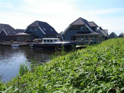 Photo for Very spacious luxury villa for 8 people on the Sneekermeer with jetty