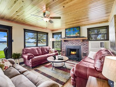 The living area in the main house includes a fireplace and lake views!