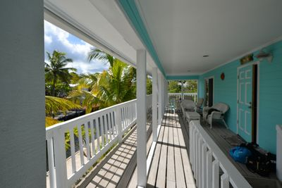 Large porch is a great place to relax and watch the boats go by