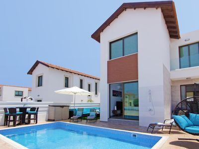 Photo for This 4-bedroom villa for up to 8 guests is located in Protaras and has a private swimming pool, air-