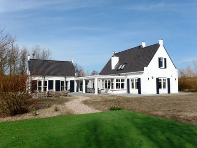 Photo for Beautiful detached 10 pers. house within walking distance of the beach in Ouddorp