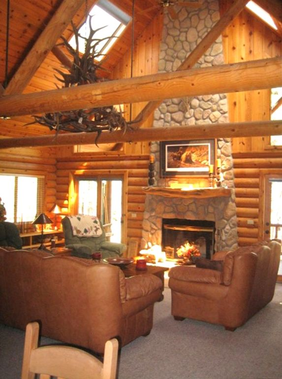 cabin with fireplace. Greatroom w  Stunning Floor to Ceiling Native Rock Fireplace Beautiful cabin with guest make your VRBO
