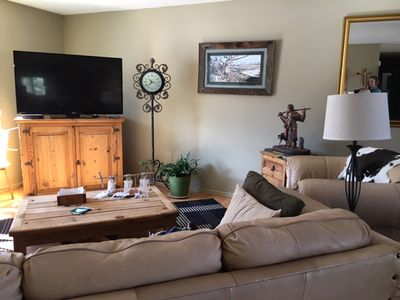 living room from the kitchen, large screen with HBO and Netflix