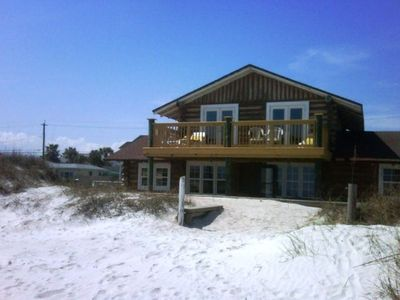 Photo for TONS OF CHARACTER AND AMBIANCE IN THIS COZY LOG CABIN DIRECTLY ON THE BEACH!