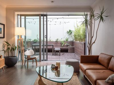 Photo for Modern 1 Bedroom Apartment with Spacious Courtyard in CBD