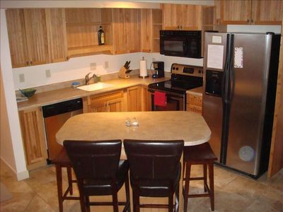 Fully-equipped & uber-clean kitchen with stainless steel appliances