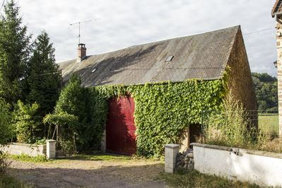 Part of the house with the barn
