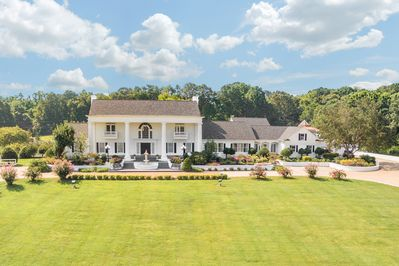 Exterior view of the front of the Mansion situated on 32 private acres for you.
