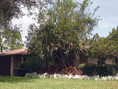 Front of home with caladiums in bloom