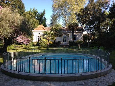 Photo for Beautiful Bordeaux house, swimming pool and tenis in 1 hectare wooded park