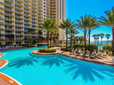 Photo for Beach front condo with lagoon pool. Sleeps 6! Snowbirds special pricing!