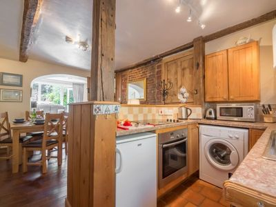 Photo for A lovely old fisherman's cottage bursting with character and charm