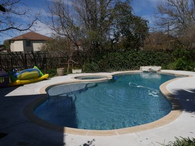 Newly renovated pool & pool floats including an inflatable volleyball net & ball