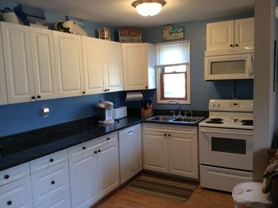 Welcome to the new kitchen -- dishwasher, 2 x's the cabinets, appliance upgrade!