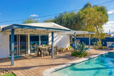 Poolside Patio - Welcome to Palm Springs! This home is professionally managed by TurnKey Vacation Rentals.