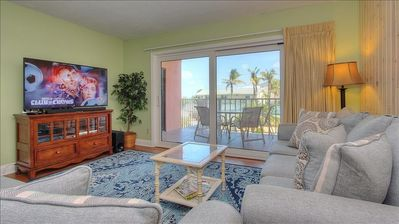 Photo for Experience Swaying Palms and Beachfront Bliss in Central Indian Rocks Beach!