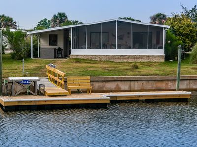 View from canal, showing boat dock, fish cleaning table and porch